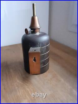 Ancienne lampe Pigeon dite grenade à plaque rapportée