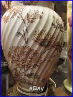 Paire de lampes epoque XIXe en faience et bronze decor floral